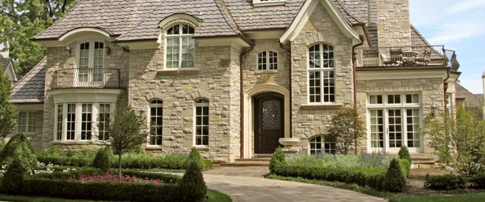 Old, large, stone front house.